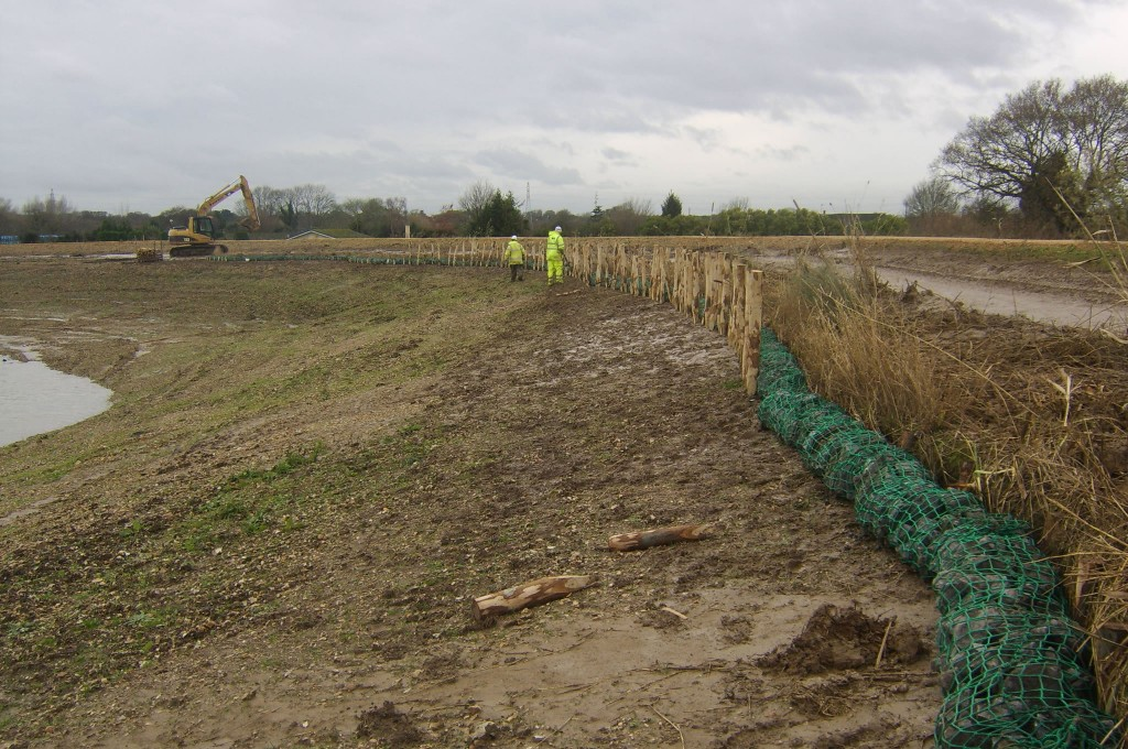 Rock Roll protection to face of Coir Rolls on reservoir shoreline