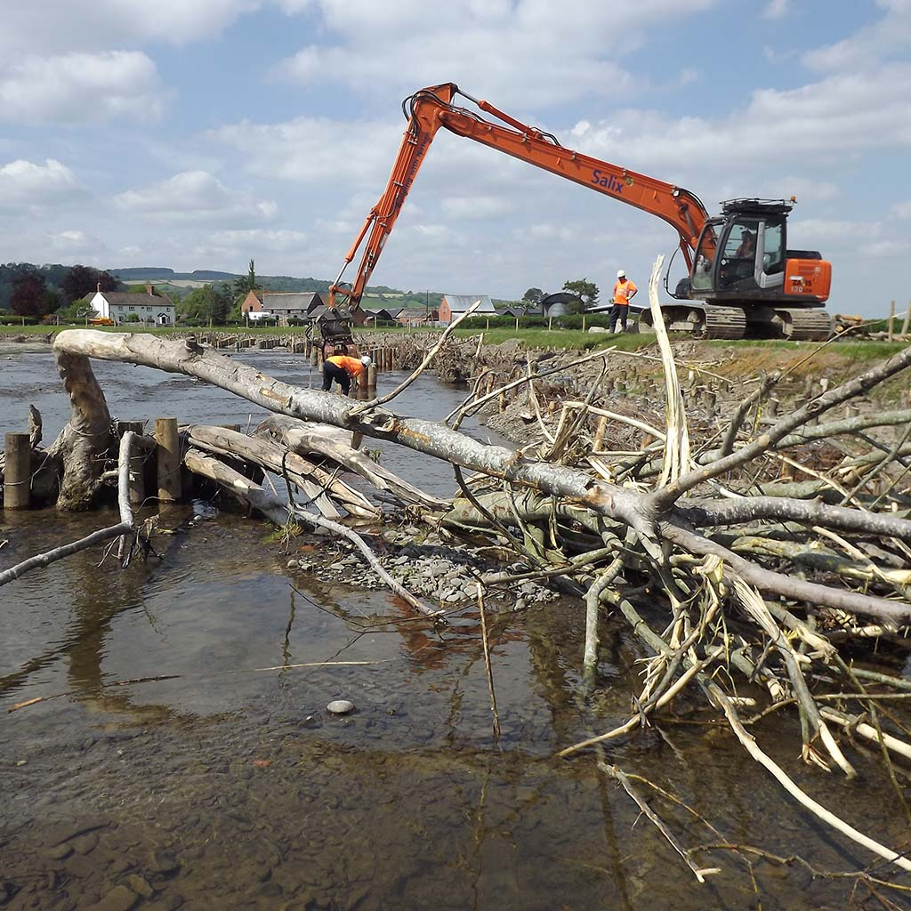 River Restoration Specialists using long reach excavator to place large woody debris